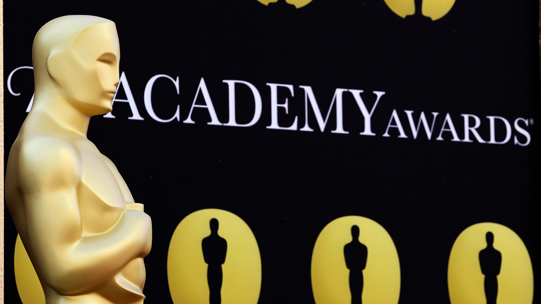 FILE - In this March 5, 2010 file photo, an Oscar statue stands on the red carpet outside the Kodak Theatre as preparations continue for the 82nd Academy Awards in Los Angeles, Calif. The motion picture academy says it's extending the deadline for members to vote for the Academy Awards to Jan. 4,  2013, following criticism of its new electronic voting system. The 85th annual Academy Awards are scheduled for Feb. 24, 2013. (AP Photo/Amy Sancetta, File)
