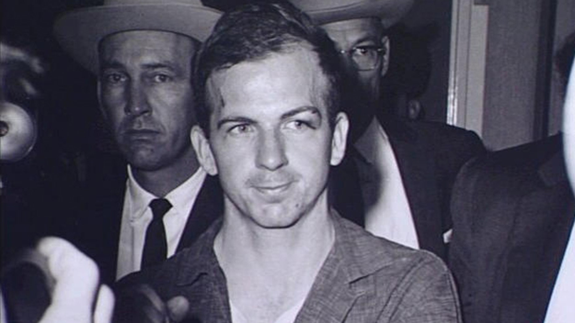 Decades after Kennedy's assassination, many still wonder whether Oswald acted alone or had help.