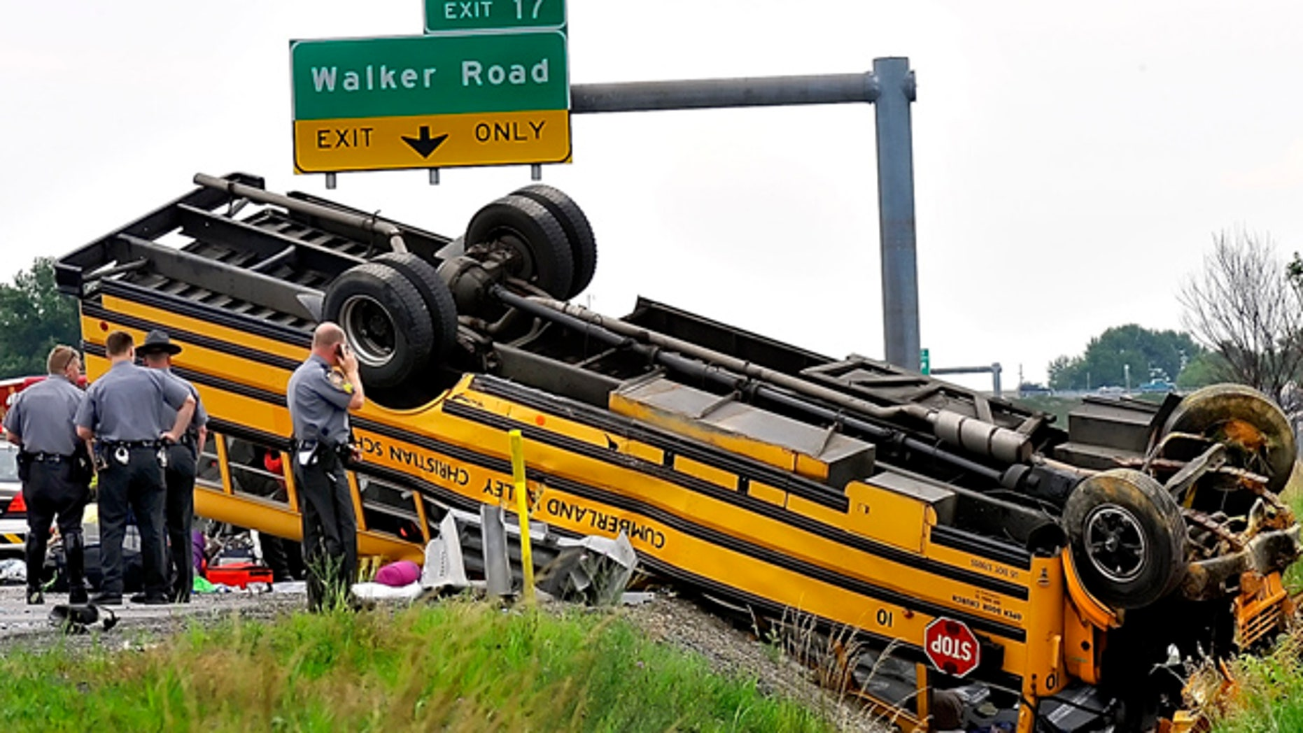 June 26: Pennsylvania State Police look over an overturned school bus after it was involved in a accident with another vehicle on Interstate 81 in Chambersburg, Pa.