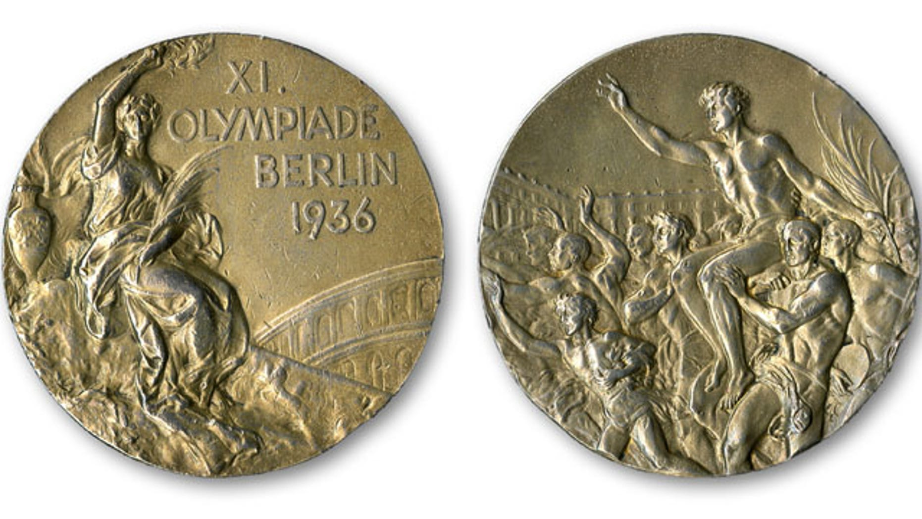 December 2, 2013: This handout provided by SCP Auctions, Inc., shows the front, left, and back, right, of one of Jesse Owens' four gold medals won at the 1936 Olympics in Berlin. SCP Auctions says the medal could go for more than $1 million when the auction opens. (AP Photo/SCP Auctions, Inc.)