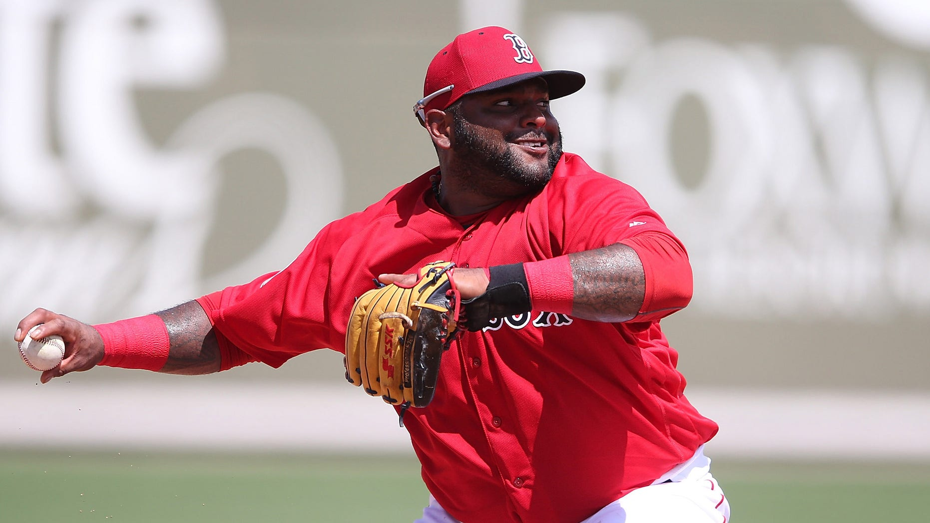 FORT MYERS, - MARCH 14: Pablo Sandoval #48 of the Boston Red Sox makes the throw to first on the ground ball from Jason Rogers (not in photo) of the Pittsburgh Pirates during the fourth inning of the Spring Training Game on March 14, 2016 at Jet Blue Park at Fenway South, Florida. The Pirates defeated the Red Sox 3-1. (Photo by Leon Halip/Getty Images)