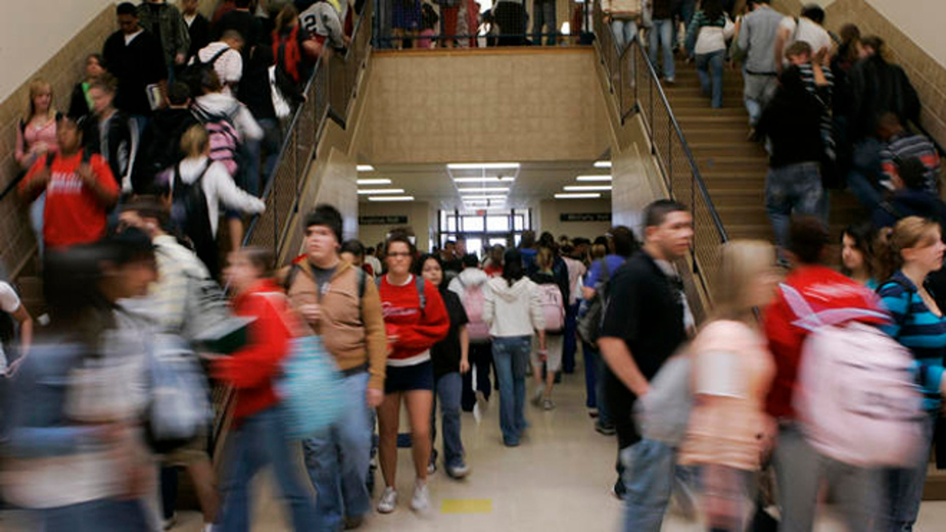 ** ADVANCE FOR SUNDAY, AUG. 19 **Students move between classes at Dodge City High School in Dodge City, Kan., Wednesday, April 4, 2007. Seventy per cent of the students at the school are Hispanic. (AP Photo/Orlin Wagner)