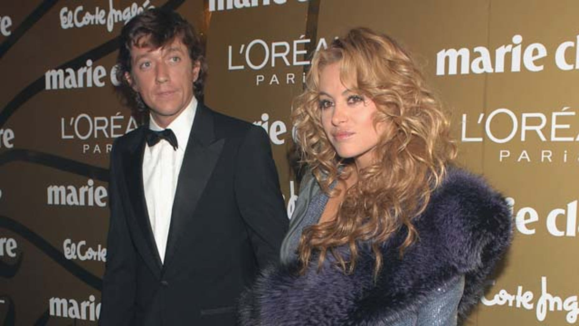 """MADRID, SPAIN - NOVEMBER 22:  Singer Paulina Rubio (R) and husband Nicolas """"Colate"""" Vallejo Najera attend the 5th Marie Claire Magazine Awards at the French Embassy November 22, 2007 in Madrid, Spain.  (Photo by Carlos Alvarez/Getty Images)"""