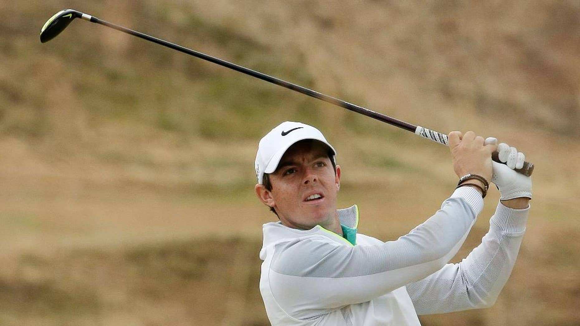 FILE - In this Thursday, June 18, 2015 file photo, Rory McIlroy, of Northern Ireland, watches his tee shot on the 10th hole during the first round of the U.S. Open golf tournament at Chambers Bay in University Place, Wash.  Rory McIlroy posted two videos on Instagram that suggest he might be able to return for the PGA Championship, Thursday, Aug. 6, 2015. (AP Photo/Charlie Riedel, File)