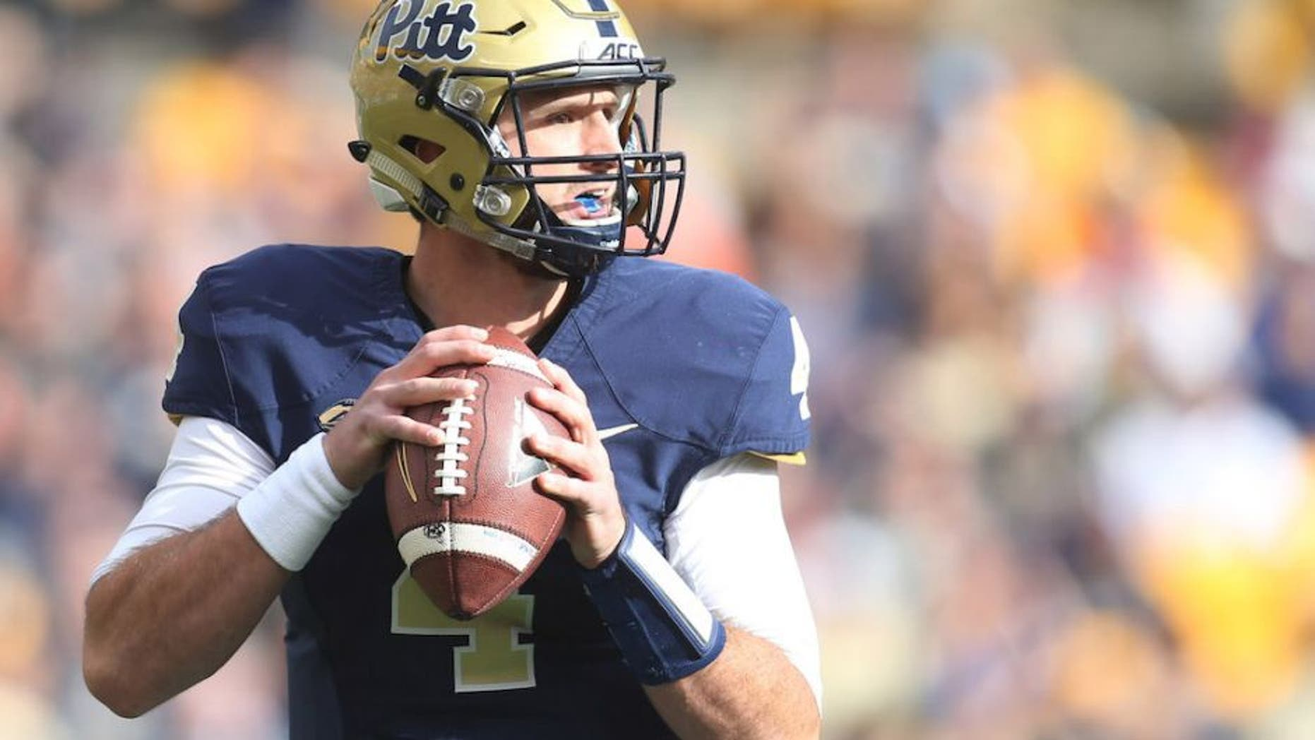 Nov 27, 2015; Pittsburgh, PA, USA; Pittsburgh Panthers quarterback Nathan Peterman (4) looks to pass against the Miami Hurricanes during the first quarter at Heinz Field. Mandatory Credit: Charles LeClaire-USA TODAY Sports