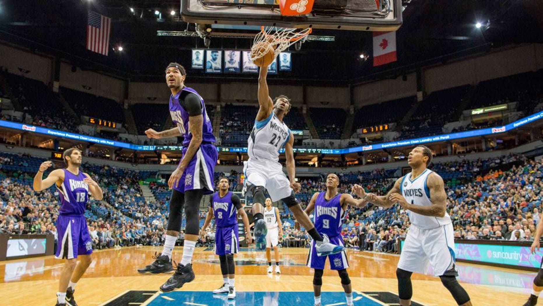 Minnesota Timberwolves guard Andrew Wiggins dunks the ball past Sacramento Kings center Willie Cauley-Stein.