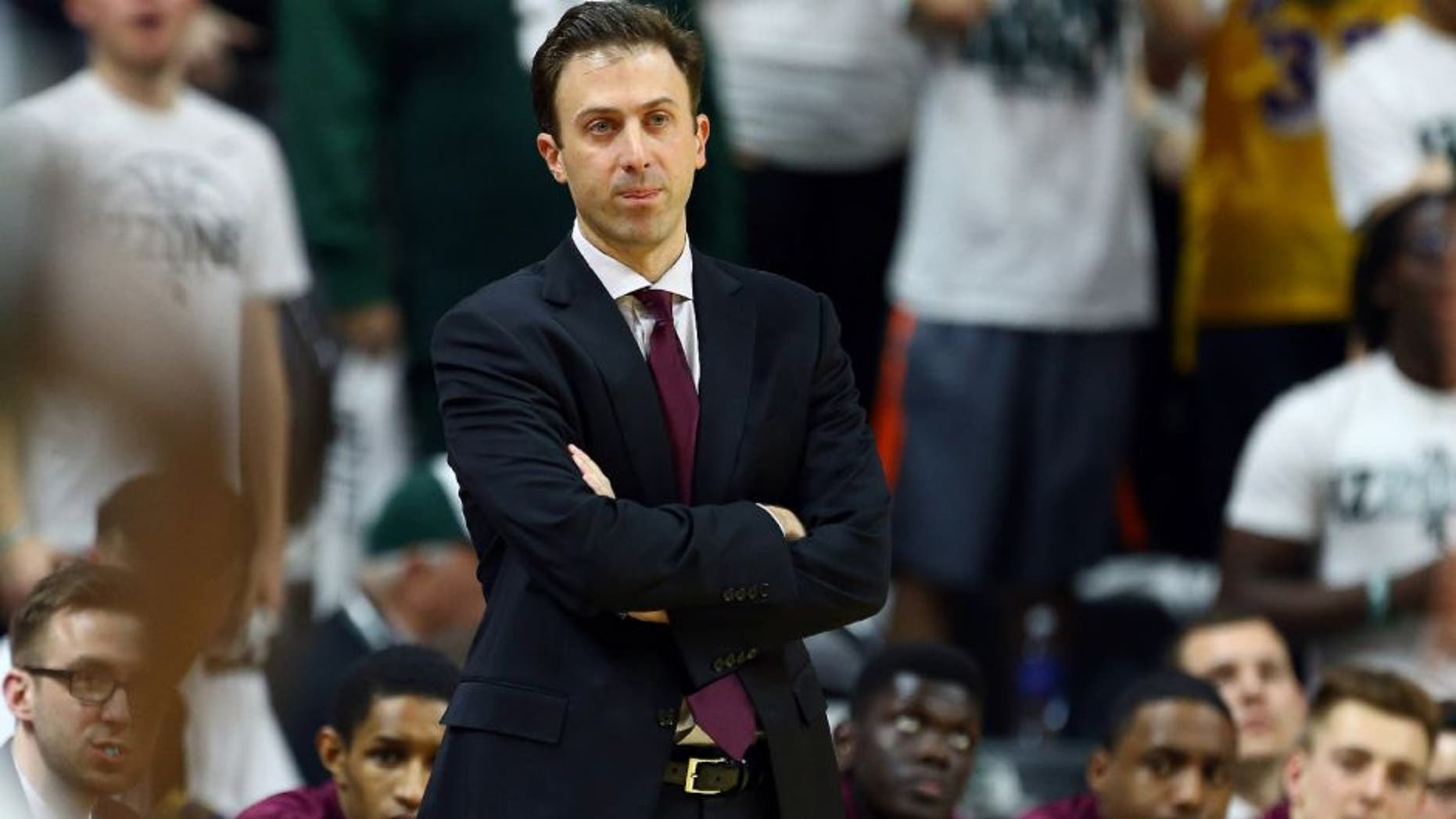 Feb 26, 2015; East Lansing, MI, USA; Minnesota Golden Gophers head coach Richard Pitino reacts to a play during the 1st half of a game at Jack Breslin Student Events Center.