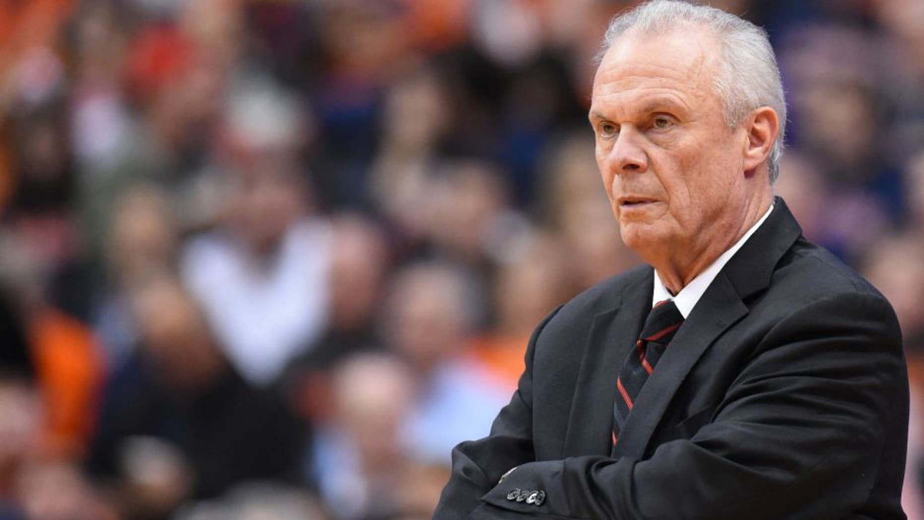 Former Wisconsin Badgers head coach Bo Ryan reacts to a play against the Syracuse Orange during the first half at the Carrier Dome.