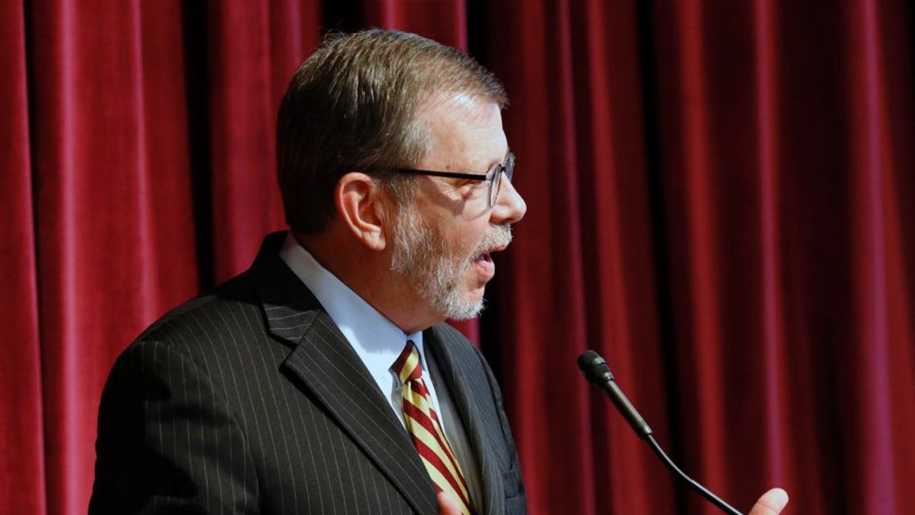 University of Minnesota President Eric Kaler addresses questions after he announced the resignation of athletic director Norwood Teague, Friday, Aug. 7, 2015 in Minneapolis.