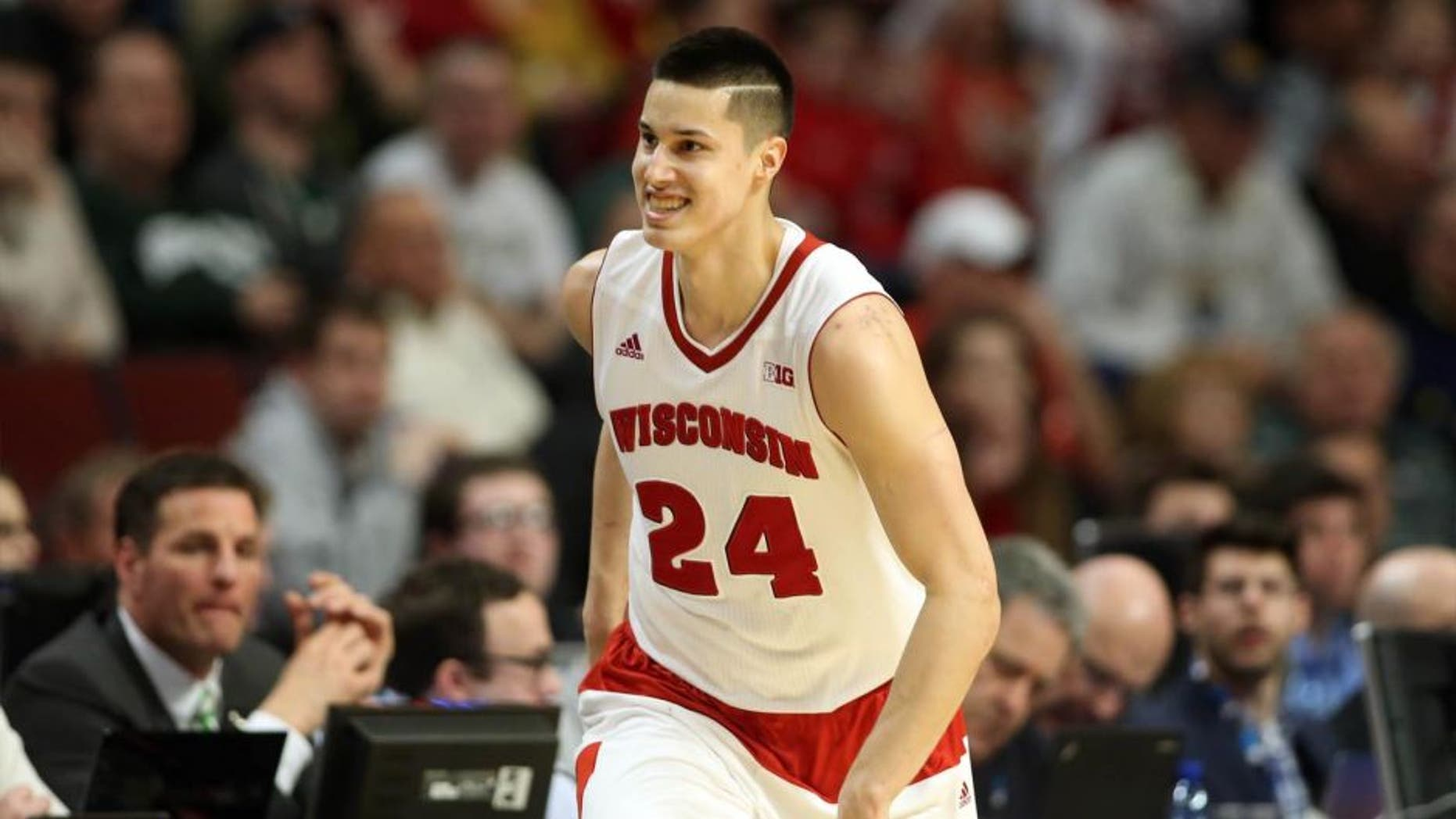 Wisconsin Badgers guard Bronson Koenig reacts after making a three-pointer against the Purdue Boilermakers during the second half in the semifinals of the Big Ten tournament in Chicago.