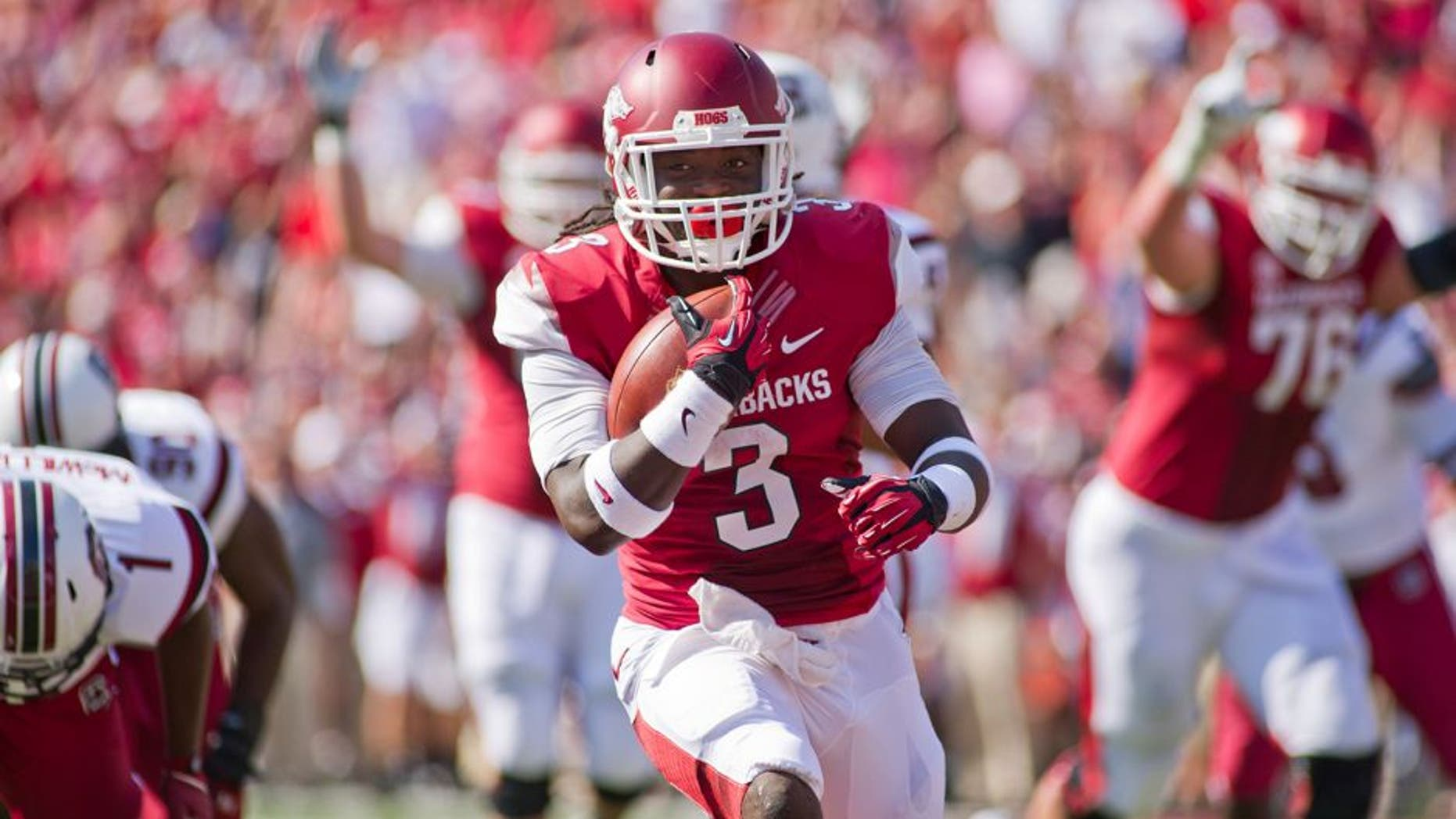 Oct 12, 2013; Fayetteville, AR, USA; Arkansas Razorbacks running back Alex Collins (3) runs with the ball during a game against the South Carolina Gamecocks at Donald W. Reynolds Razorback Stadium. South Carolina defeated Arkansas 52-7. Mandatory Credit: Beth Hall-USA TODAY Sports
