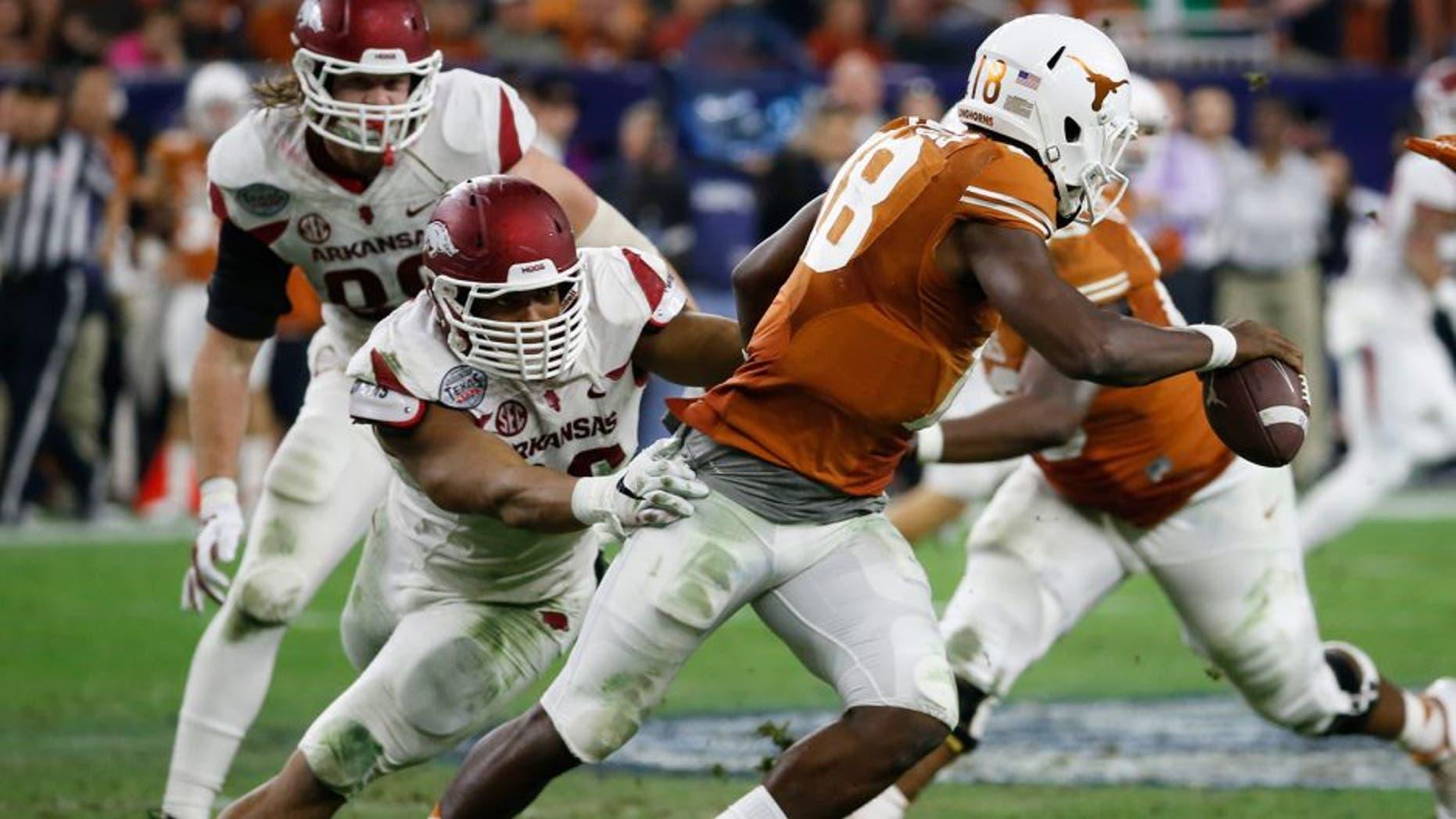Dec 29, 2014; Houston, TX, USA; Arkansas Razorbacks defensive end Trey Flowers (86) sacks Texas Longhorns quarterback Tyrone Swoopes (18) during the first half in the 2014 Texas Bowl at NRG Stadium. Mandatory Credit: Kevin Jairaj-USA TODAY Sports