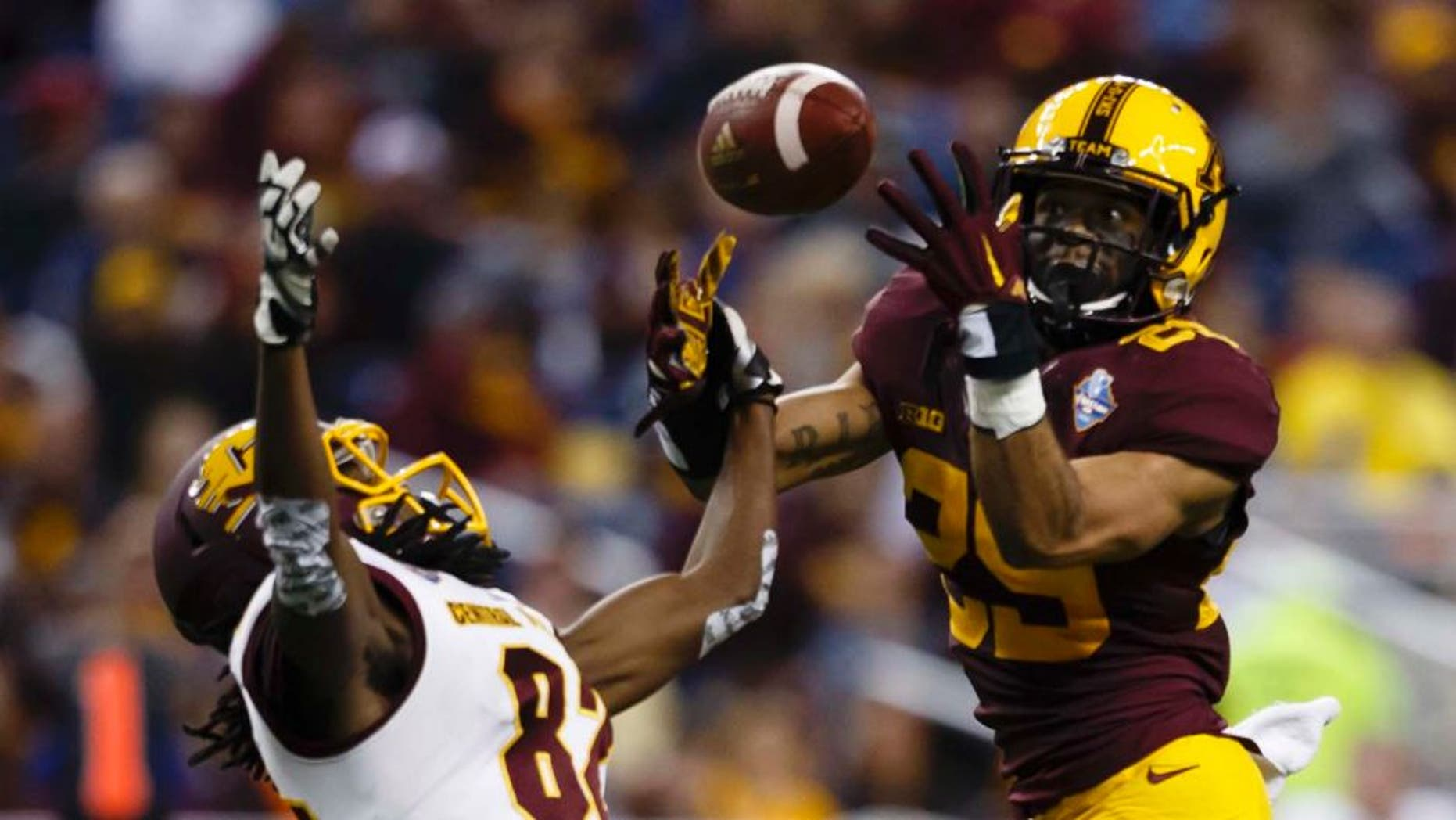 Minnesota Golden Gophers defensive back Briean Boddy-Calhoun (right) breaks up a pass to Central Michigan Chippewas wide receiver Corey Willis in the first half at Ford Field in Detroit on Monday, Dec. 28, 2015.