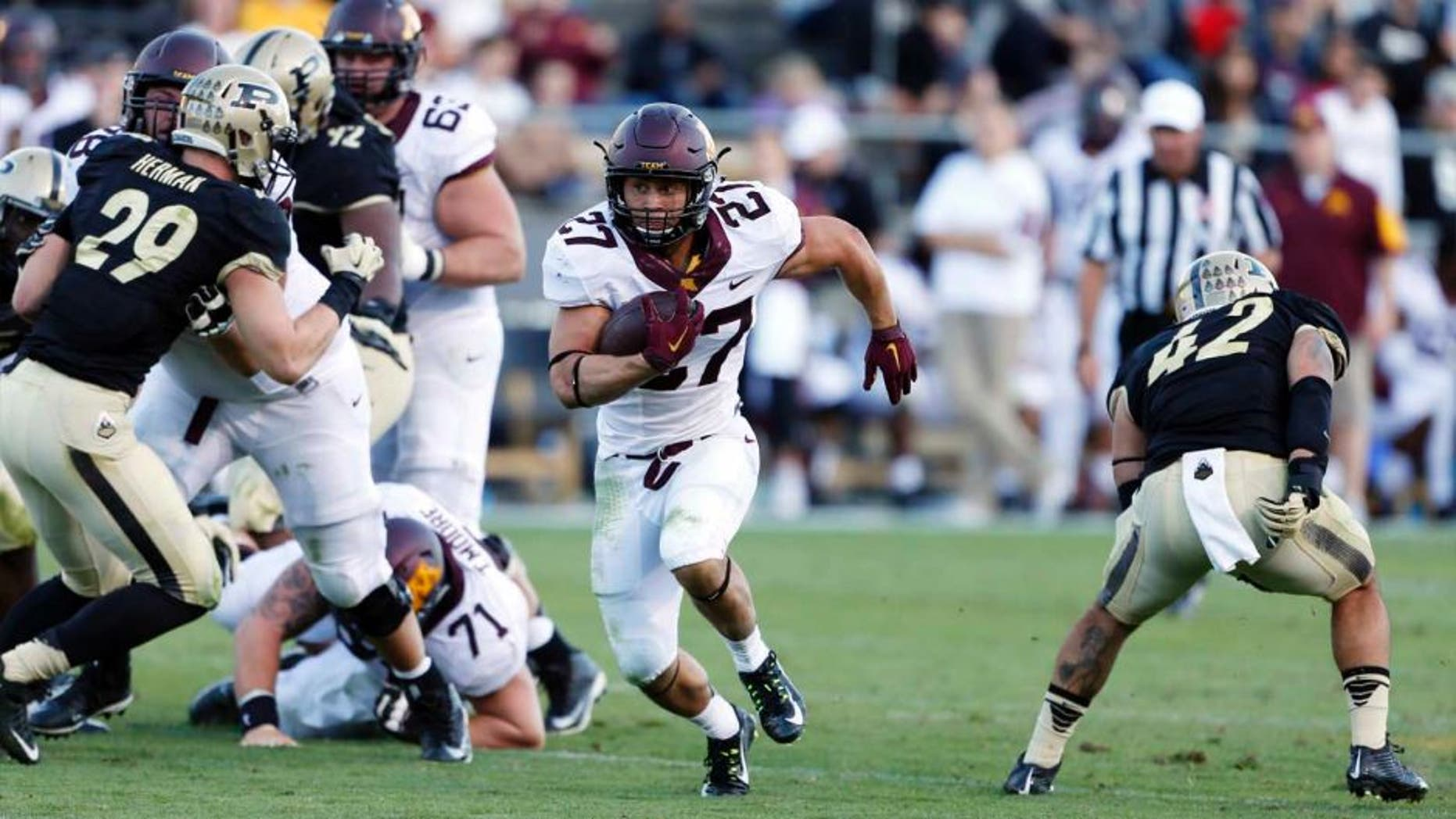 Minnesota Golden Gophers running back Shannon Brooks runs with the ball against the Purdue Boilermakers at Ross Ade Stadium in West Lafayette, Ind., on Saturday, Oct. 10, 2015. Minnesota won 41-13.