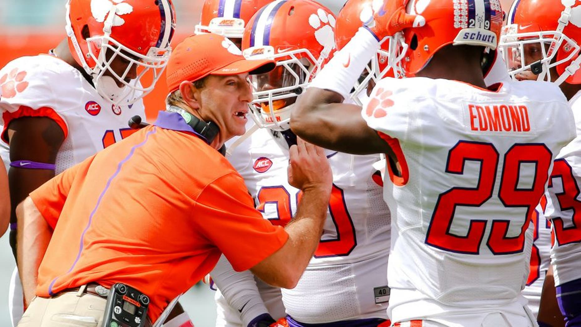 Oct 24, 2015; Miami Gardens, FL, USA; Clemson Tigers head coach Dabo Swinney talks with his players during the first half against the Miami Hurricanes at Sun Life Stadium. Mandatory Credit: Steve Mitchell-USA TODAY Sports