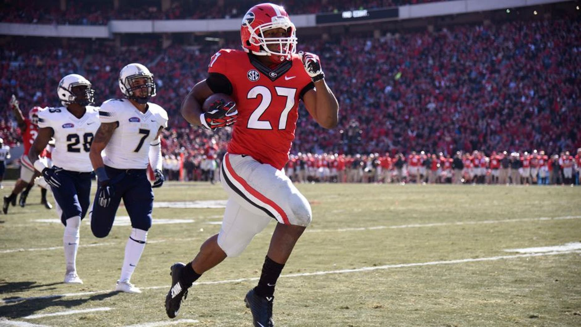 Nov 22, 2014; Athens, GA, USA; Georgia Bulldogs running back Nick Chubb (27) runs 83 yards for a touchdown against the Charleston Southern Buccaneers during the first quarter at Sanford Stadium. Mandatory Credit: Dale Zanine-USA TODAY Sports