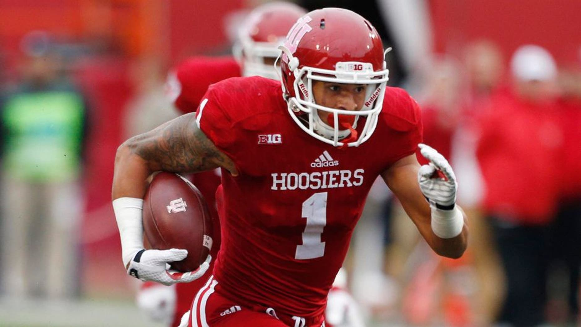 Oct 3, 2015; Bloomington, IN, USA; Indiana Hoosiers wide receiver Simmie Cobbs Jr. (1) runs with the ball after making a catch against the Ohio State Buckeyes at Memorial Stadium. Ohio State defeats Indiana 34-27. Mandatory Credit: Brian Spurlock-USA TODAY Sports