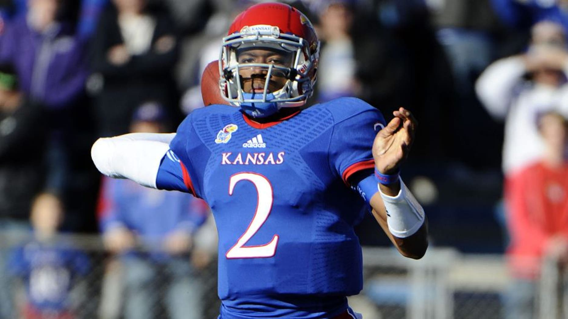 Nov 30, 2013; Lawrence, KS, USA; Kansas Jayhawks quarterback Montell Cozart (2) throws a pass against the Kansas State Wildcats in the first half at Memorial Stadium. Mandatory Credit: John Rieger-USA TODAY Sports