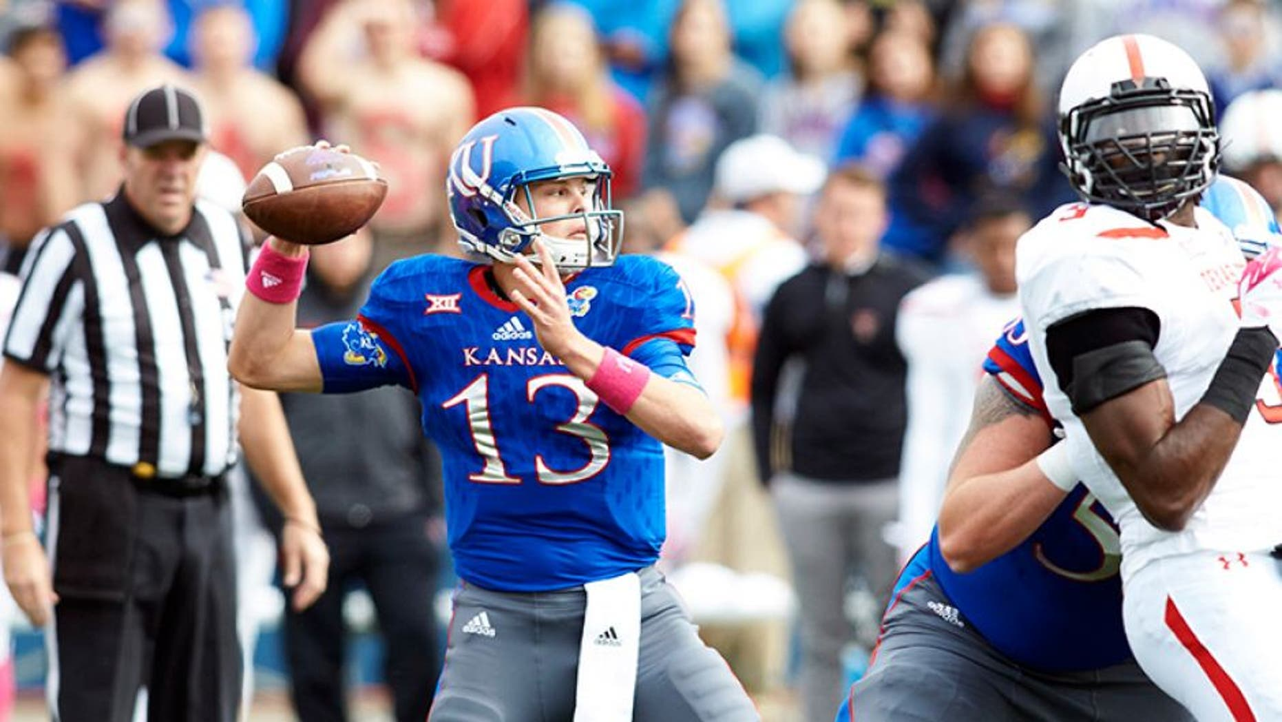 Oct 17, 2015; Lawrence, KS, USA; DUPLICATE Kansas Jayhawks quarterback Ryan Willis (13) throws the ball down the field against Texas Tech at Memorial Stadium. Mandatory Credit: Gary Rohman/MLS/USA TODAY Sports
