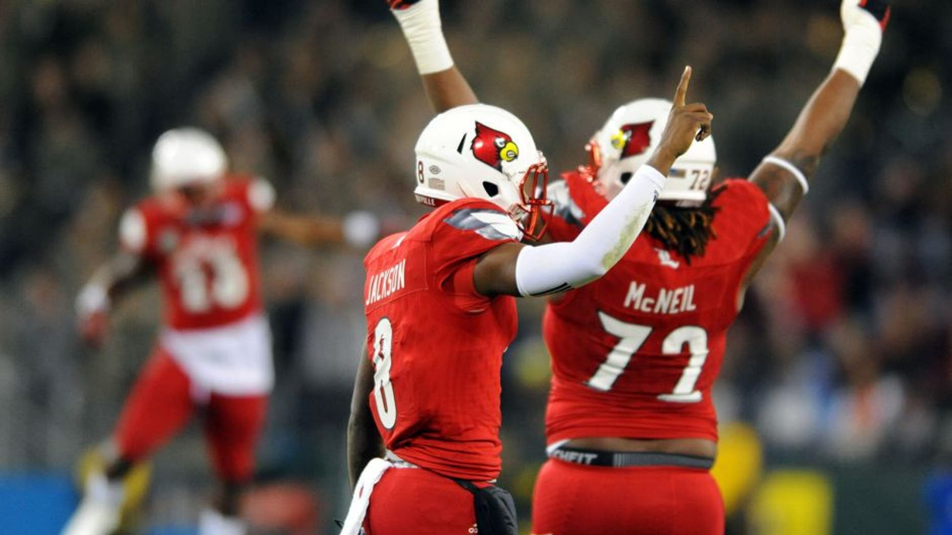 Dec 30, 2015; Nashville, TN, USA; Louisville Cardinals quarterback Lamar Jackson (8) celebrates after a 62-yard touchdown run during the first half against the Texas A&M Aggies in the 2015 Music City Bowl at Nissan Stadium. Mandatory Credit: Christopher Hanewinckel-USA TODAY Sports