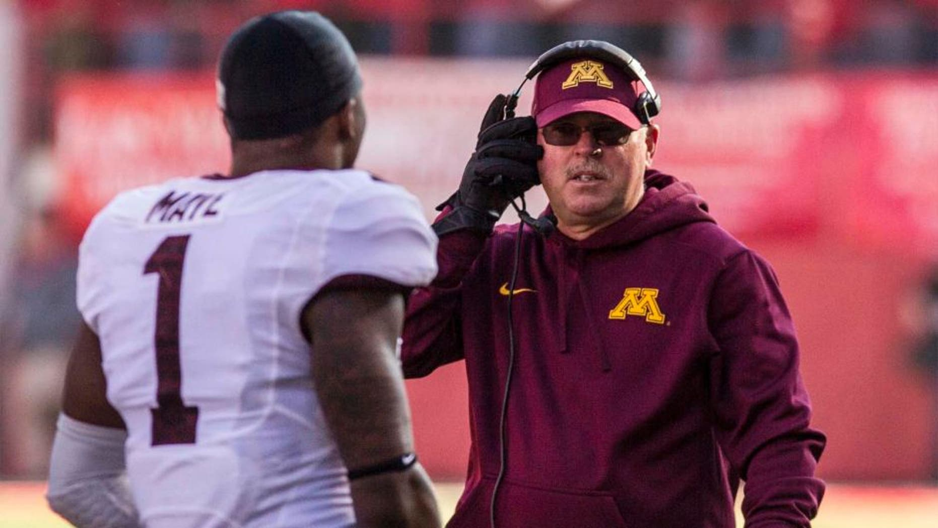 Minnesota Golden Gophers head coach Jerry Kill (right) talks to receiver KJ Maye during the second half of Minnesota's 28-24 win against the Nebraska Cornhuskers.
