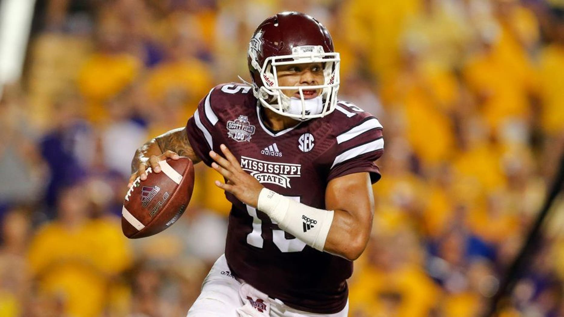 Sep 20, 2014; Baton Rouge, LA, USA; Mississippi State Bulldogs quarterback Dak Prescott (15) looks to pass against the LSU Tigers during the third quarter of a game at Tiger Stadium. Mandatory Credit: Derick E. Hingle-USA TODAY Sports