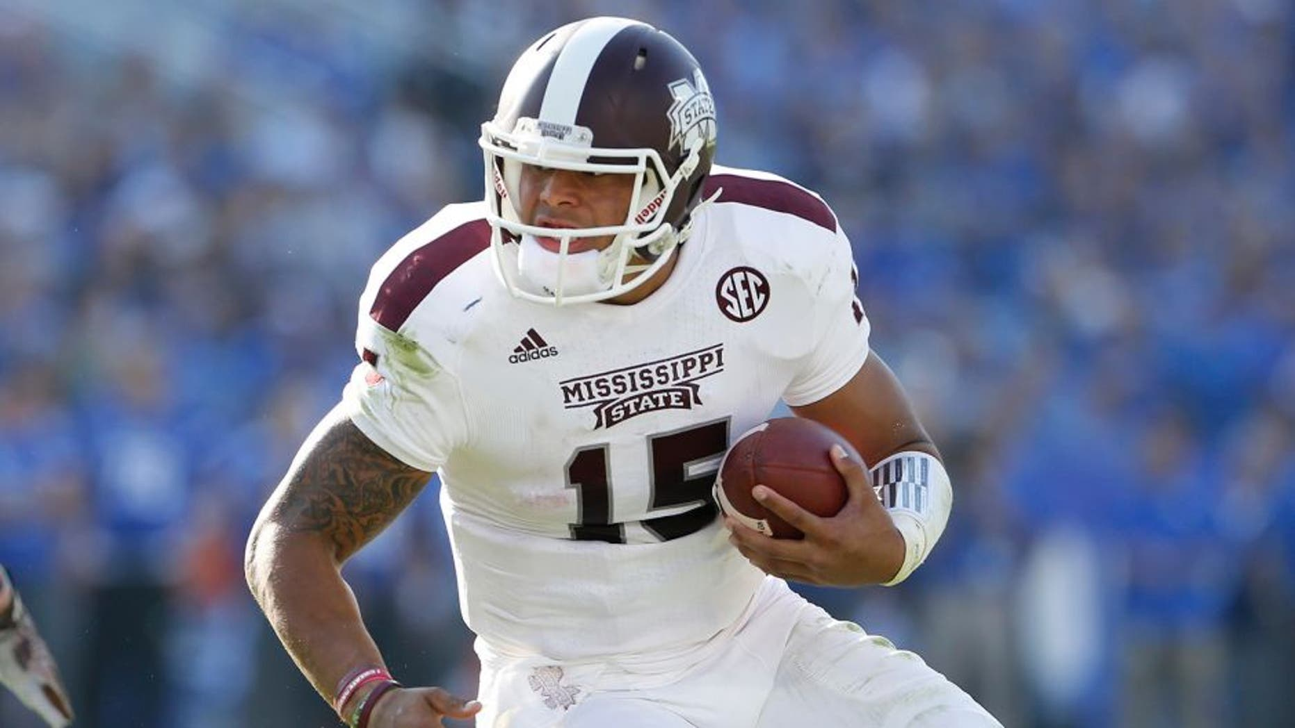 Oct 25, 2014; Lexington, KY, USA; Mississippi State Bulldogs quarterback Dak Prescott (15) runs the ball against the Kentucky Wildcats at Commonwealth Stadium. Mandatory Credit: Mark Zerof-USA TODAY Sports