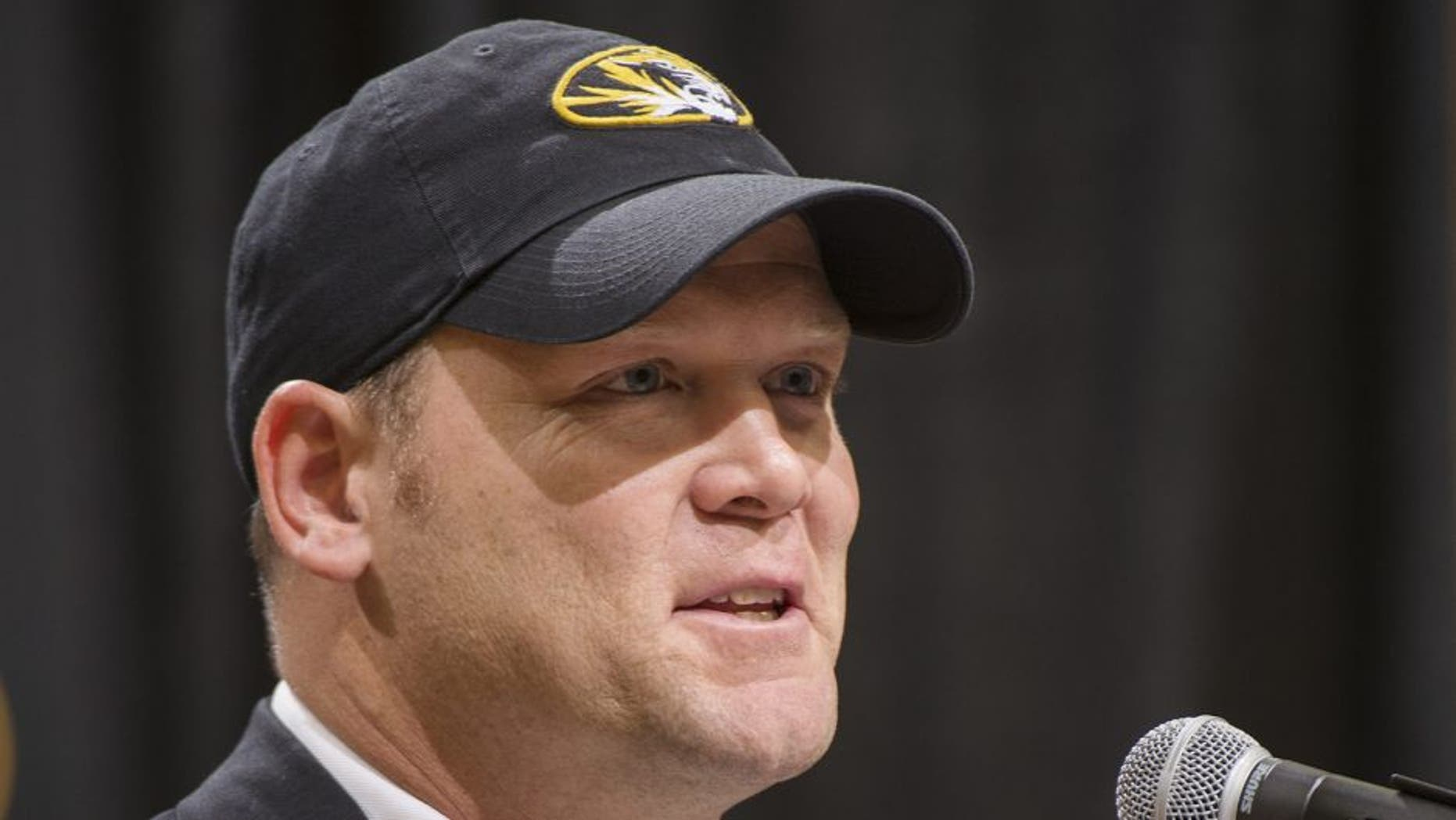Barry Odom talks to a crowd gathered at Mizzou Arena as he is announced as the new head coach for the Missouri NCAA college football team Friday, Dec. 4, 2015, in Columbia, Mo. (AP Photo/L.G. Patterson)
