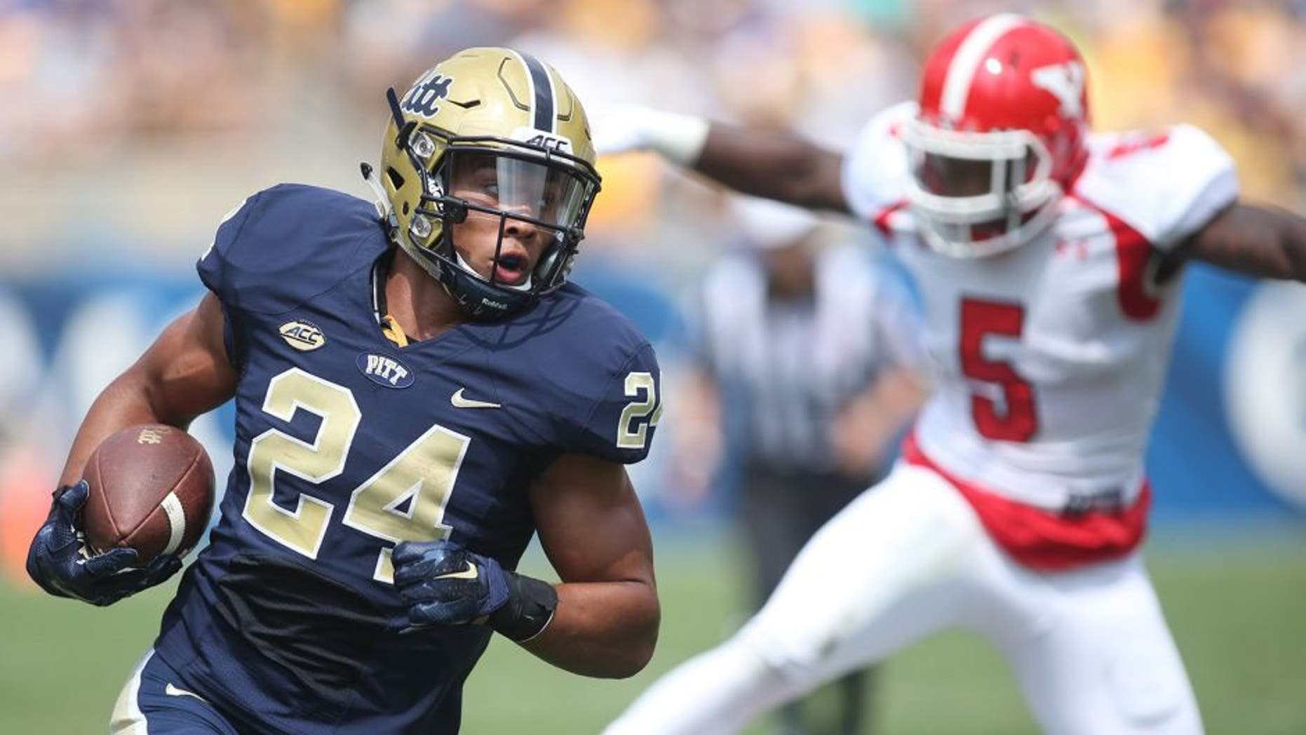 Sep 5, 2015; Pittsburgh, PA, USA; Pittsburgh Panthers running back James Conner (24) carries the ball against the Youngstown State Penguins during the first half at Heinz Field. Mandatory Credit: Charles LeClaire-USA TODAY Sports