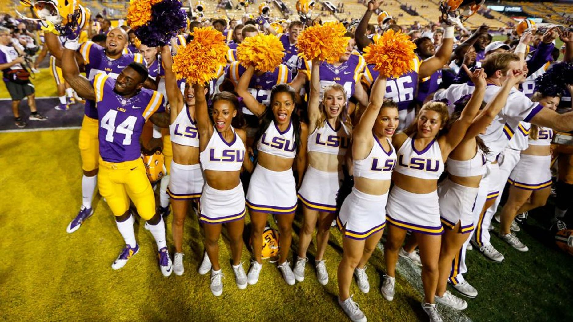 Sep 27, 2014; Baton Rouge, LA, USA; LSU Tigers players and cheerleaders celebrate following a win against the New Mexico State Aggies in a game at Tiger Stadium. LSU defeated New Mexico State 63-7. Mandatory Credit: Derick E. Hingle-USA TODAY Sports