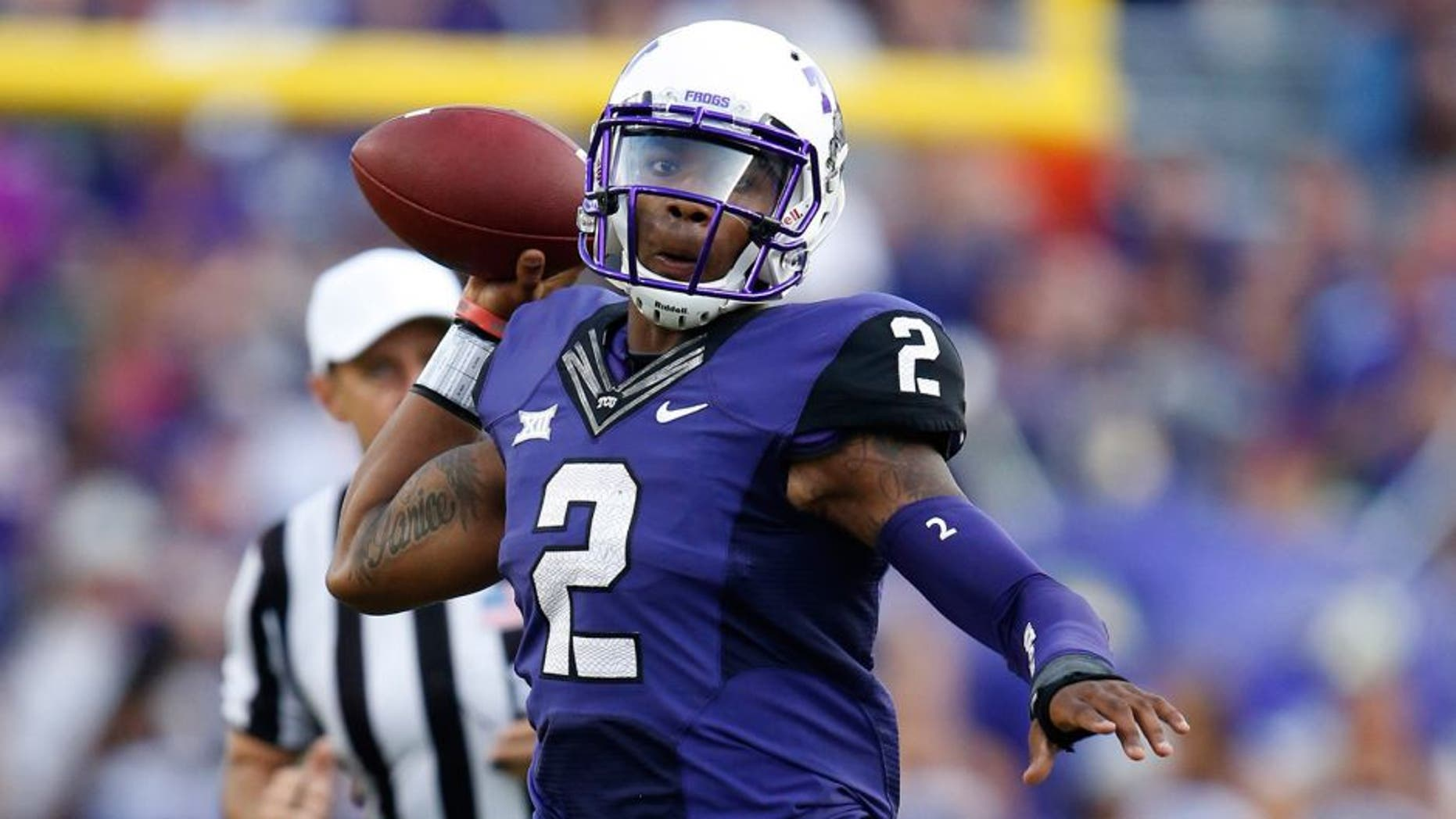 Oct 18, 2014; Fort Worth, TX, USA; TCU Horned Frogs quarterback Trevone Boykin (2) scrambles out of the pocket against the Oklahoma State Cowboys at Amon G. Carter Stadium. Mandatory Credit: Matthew Emmons-USA TODAY Sports