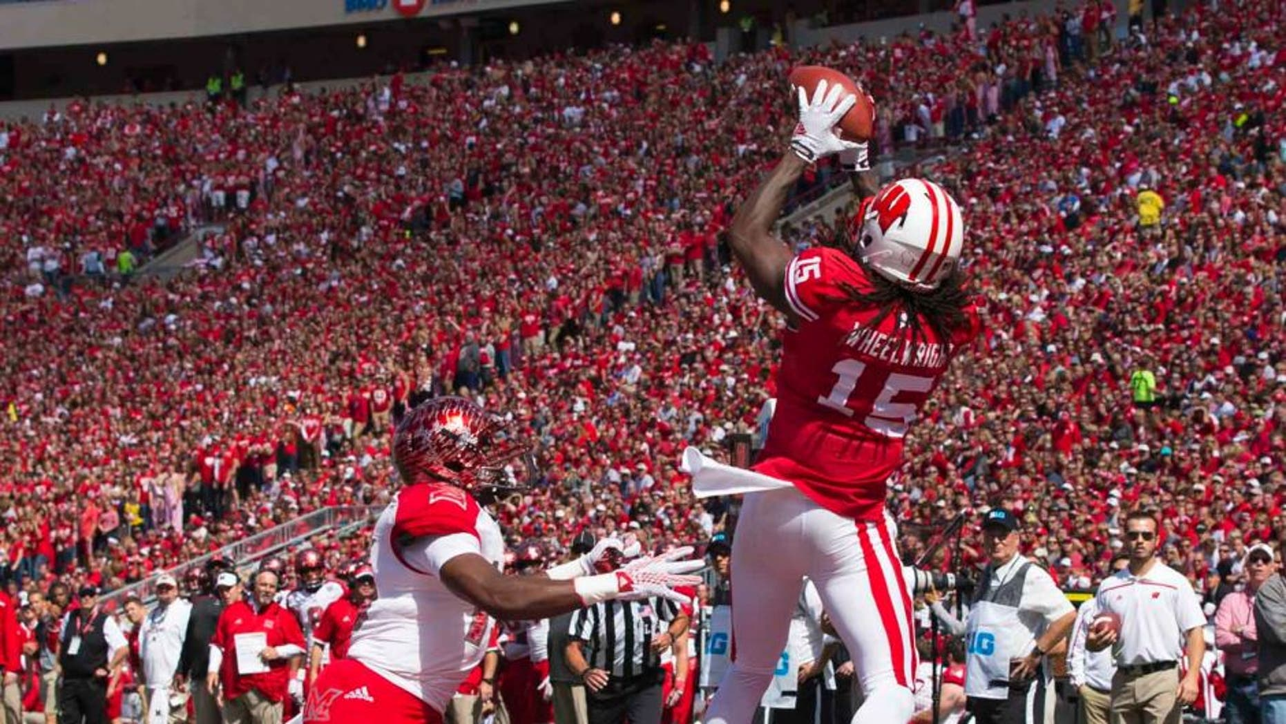 Wisconsin Badgers wide receiver Robert Wheelwright catches a touchdown pass during the second quarter against the Miami (Ohio) RedHawks at Camp Randall Stadium in Madison, Wis., on Saturday, Sept. 12, 2015.
