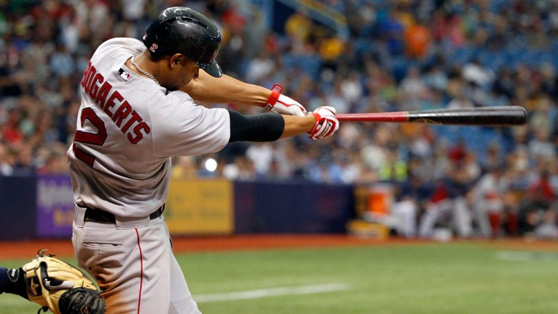 May 25, 2014; St. Petersburg, FL, USA; Boston Red Sox shortstop Xander Bogaerts (2) hits a 2-RBI single during the ninth inning against the Tampa Bay Rays at Tropicana Field. Tampa Bay Rays defeated the Boston Red Sox 8-5. Mandatory Credit: Kim Klement-USA TODAY Sports