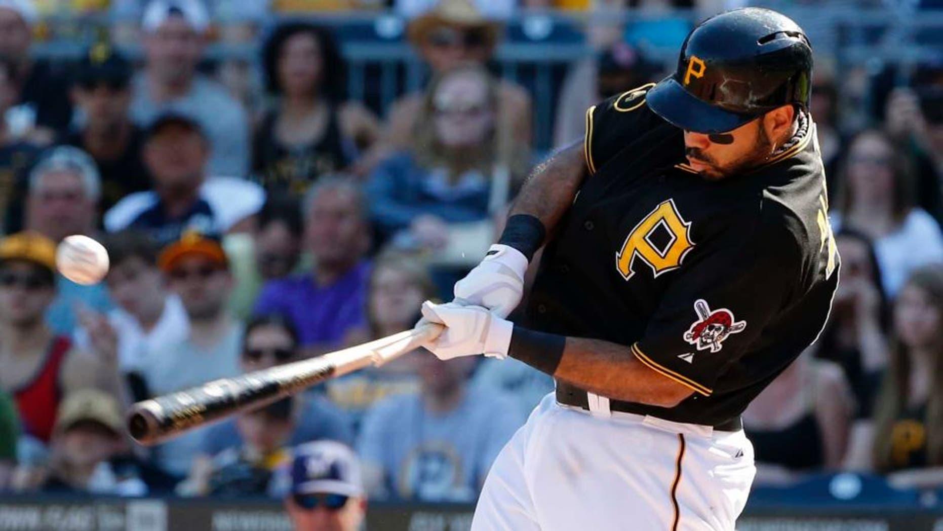 Saturday, June 7: The Pittsburgh Pirates' Pedro Alvarez drives in a run with a broken-bat single off Milwaukee Brewers starting pitcher Matt Garza during the third inning.
