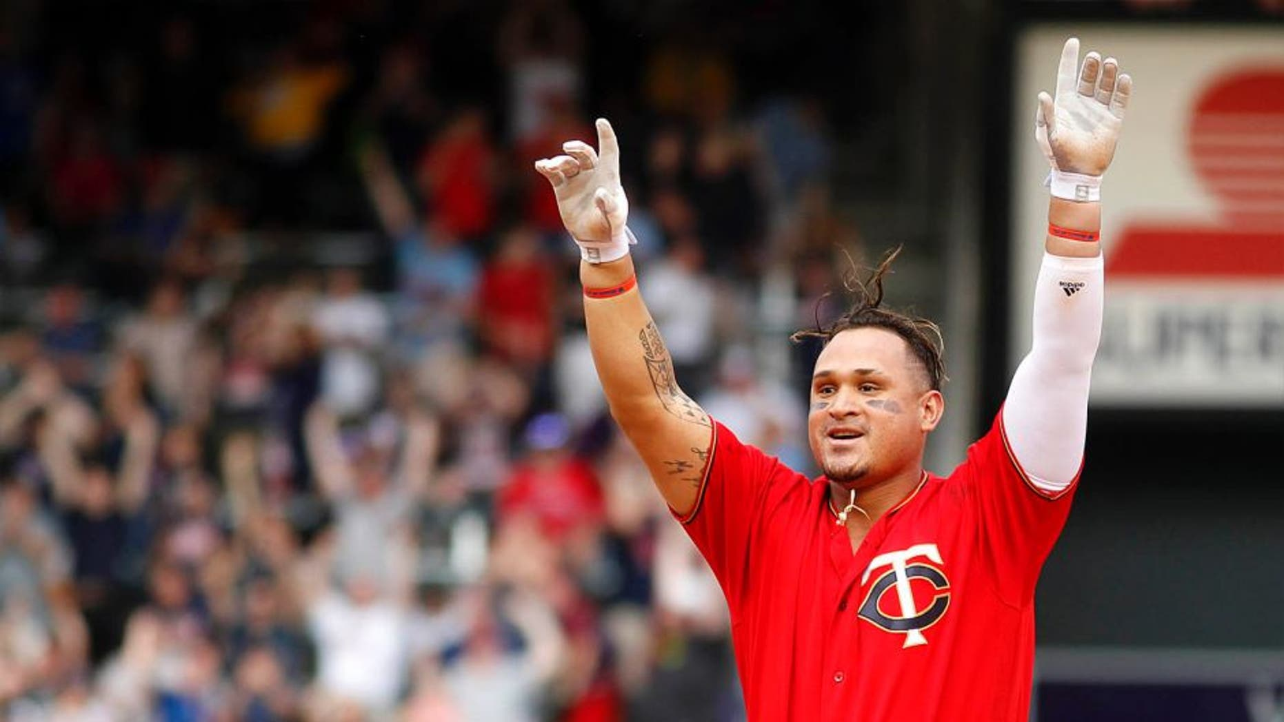The Minnesota Twins' Oswaldo Arcia celebrates after driving in the winning run against the Los Angeles Angels in the 12th inning Sunday April 17, 2016, in Minneapolis.