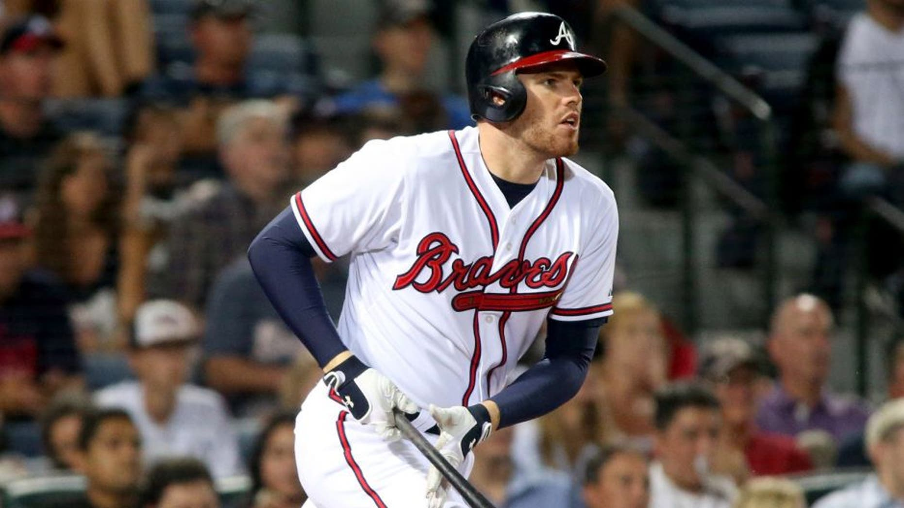 Jun 9, 2015; Atlanta, GA, USA; Atlanta Braves Freddie Freeman (5) hits a single in the sixth inning of their game against the San Diego Padres at Turner Field. Mandatory Credit: Jason Getz-USA TODAY Sports