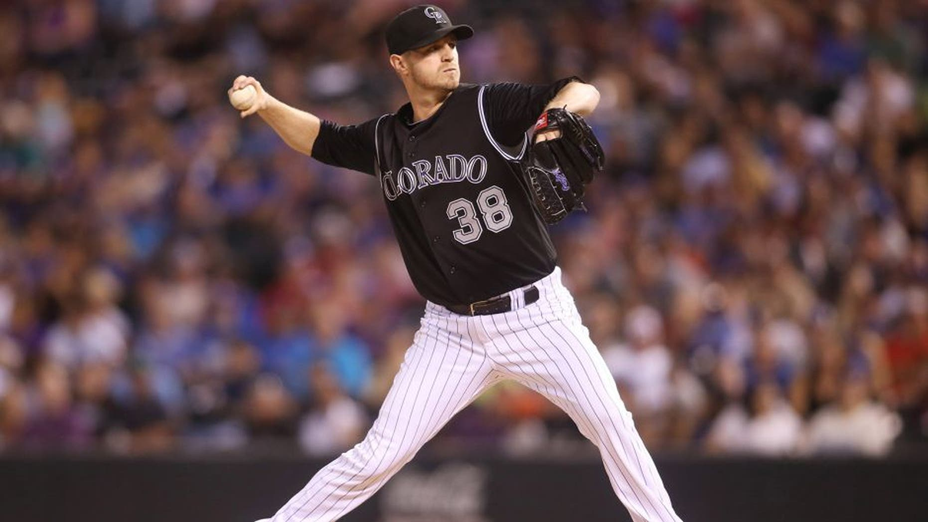 Sep 26, 2015; Denver, CO, USA; Colorado Rockies starting pitcher Kyle Kendrick (38) delivers a pitch during the fourth inning against the Los Angeles Dodgers at Coors Field. The Rockies won 8-6. Mandatory Credit: Chris Humphreys-USA TODAY Sports