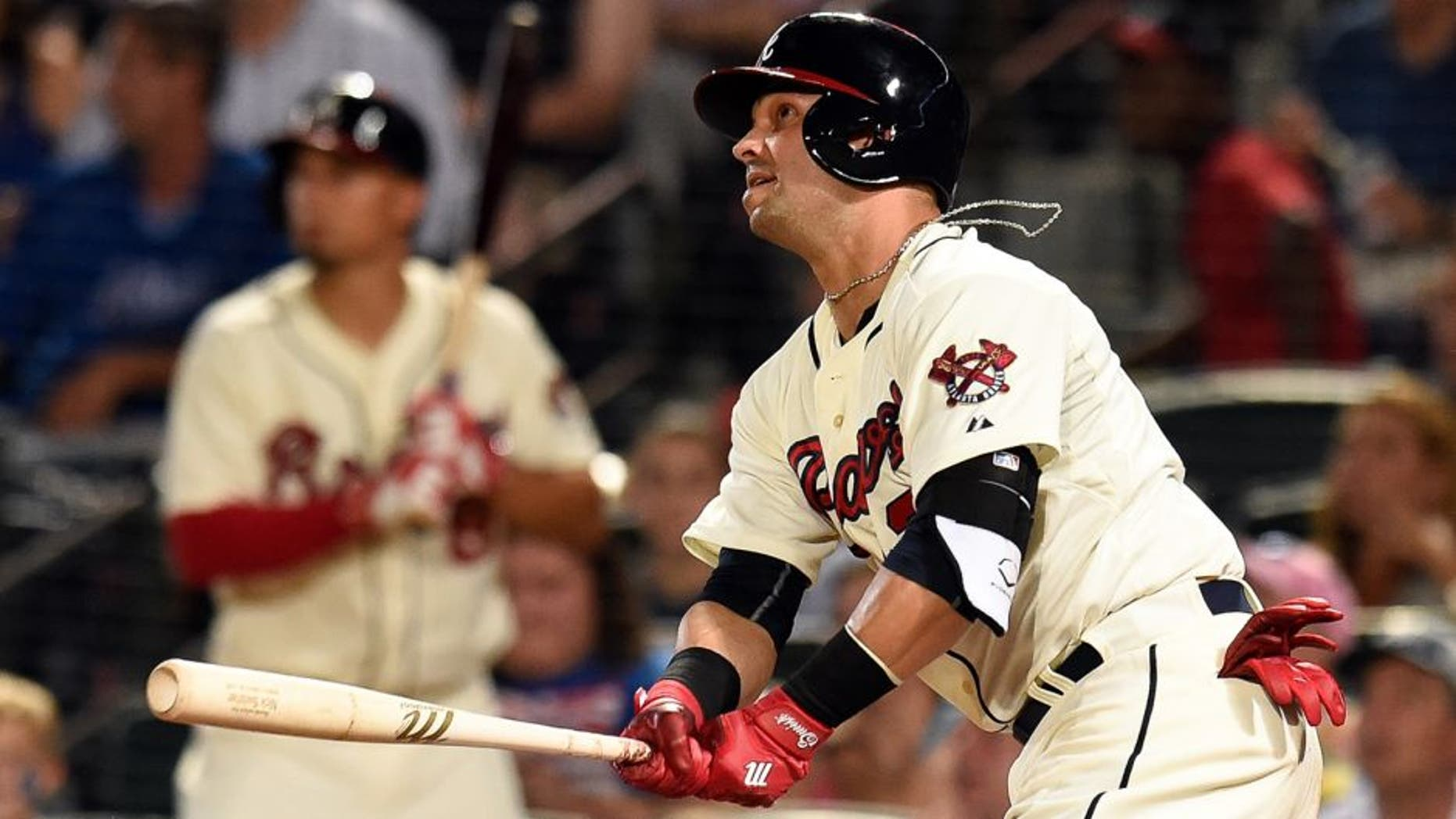 Aug 8, 2015; Atlanta, GA, USA; Atlanta Braves first baseman Nick Swisher (23) drives in two runs with a double against the Miami Marlins during the seventh inning at Turner Field. Mandatory Credit: Dale Zanine-USA TODAY Sports