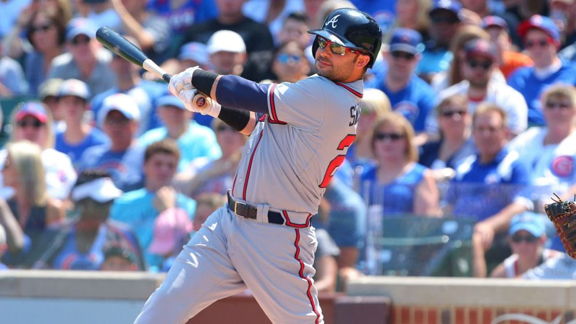 Aug 23, 2015; Chicago, IL, USA; Atlanta Braves first baseman Nick Swisher (23) hits a single during the first inning against the Chicago Cubs at Wrigley Field. Mandatory Credit: Dennis Wierzbicki-USA TODAY Sports