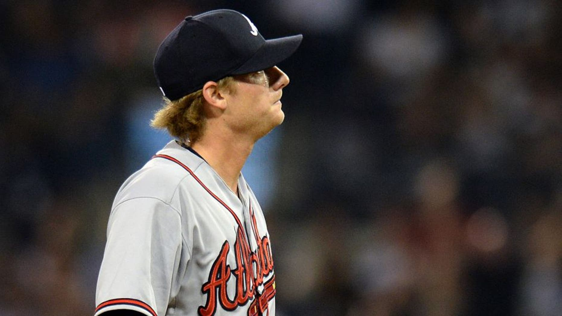 Aug 18, 2015; San Diego, CA, USA; Atlanta Braves relief pitcher Ross Detwiler (56) reacts during the sixth inning against the San Diego Padres at Petco Park. Mandatory Credit: Jake Roth-USA TODAY Sports