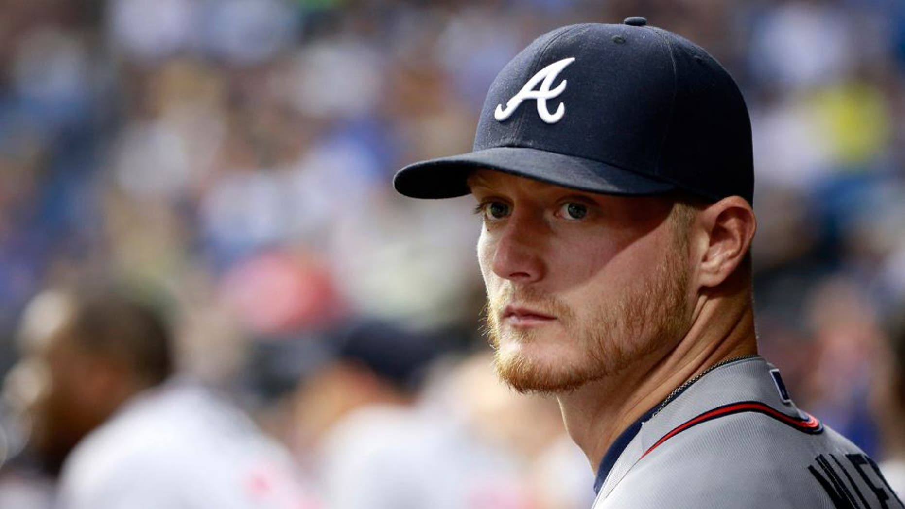 Aug 12, 2015; St. Petersburg, FL, USA; Atlanta Braves pitcher Shelby Miller (17) looks on in the dugout against the Tampa Bay Rays at Tropicana Field. Mandatory Credit: Kim Klement-USA TODAY Sports