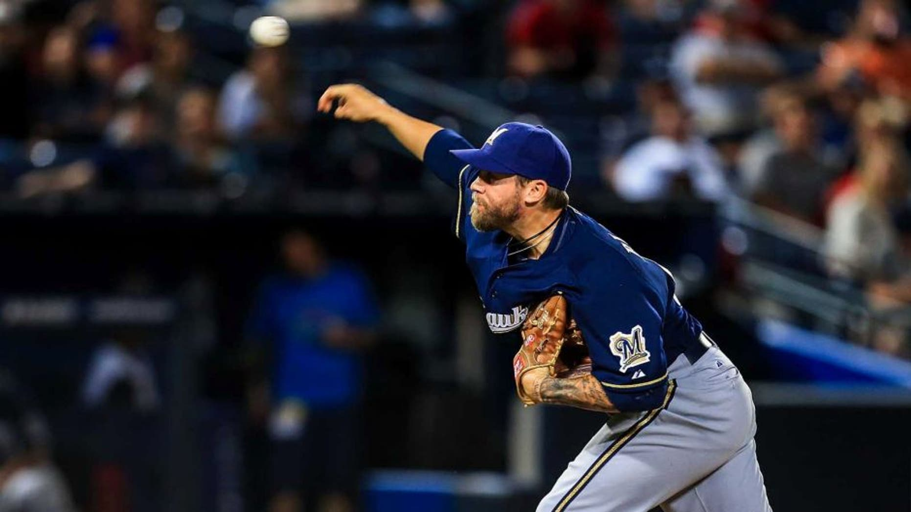 Sep 23, 2013; Atlanta, GA, USA; Milwaukee Brewers relief pitcher Michael Blazek (54) pitches in the ninth inning against the Atlanta Braves at Turner Field. The Brewers won 5-0. Mandatory Credit: Daniel Shirey-USA TODAY Sports