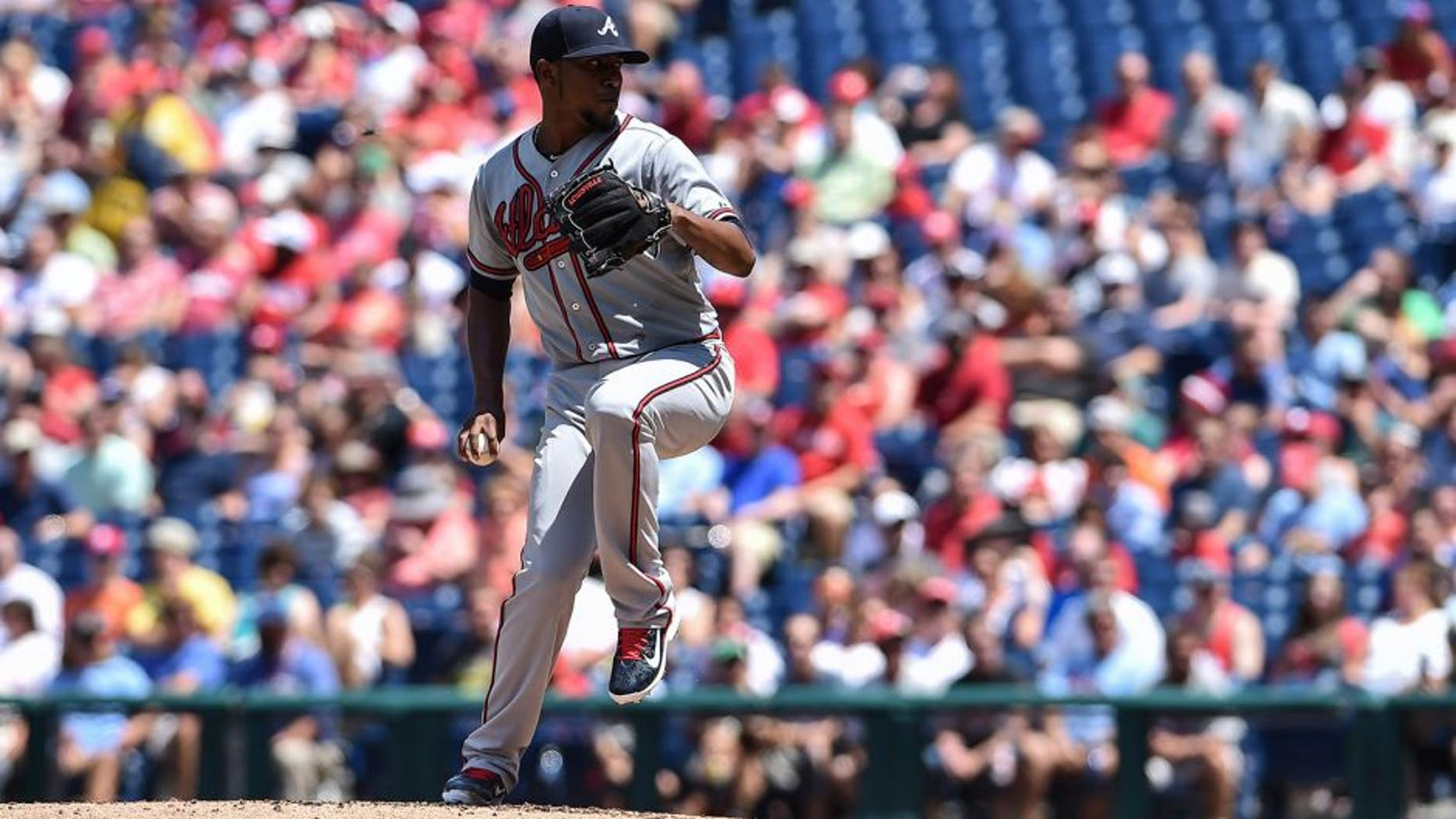 Aug 2, 2015; Philadelphia, PA, USA; Atlanta Braves starting pitcher Julio Teheran (49) pitches during the first inning of game against the Philadelphia Phillies at Citizens Bank Park. Mandatory Credit: John Geliebter-USA TODAY Sports