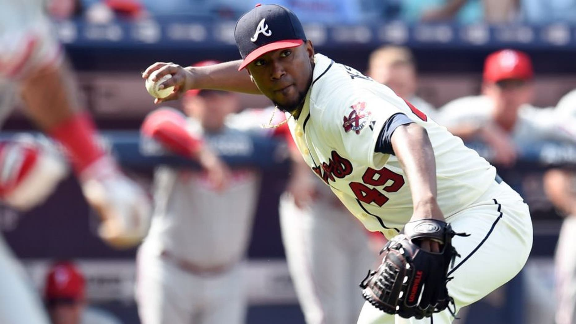 Sep 20, 2015; Atlanta, GA, USA; Atlanta Braves starting pitcher Julio Teheran (49) throws out a Philadelphia Phillies batter during the ninth inning at Turner Field. The Braves defeated the Phillies 2-1. Mandatory Credit: Dale Zanine-USA TODAY Sports