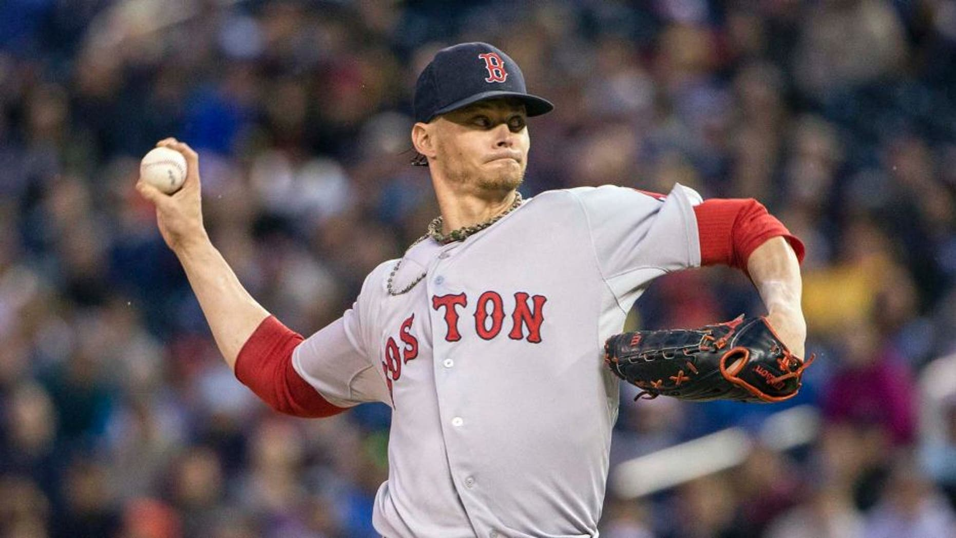May 26, 2015; Minneapolis, MN, USA; Boston Red Sox starting pitcher Clay Buchholz delivers a pitch in the first inning against the Minnesota Twins at Target Field.