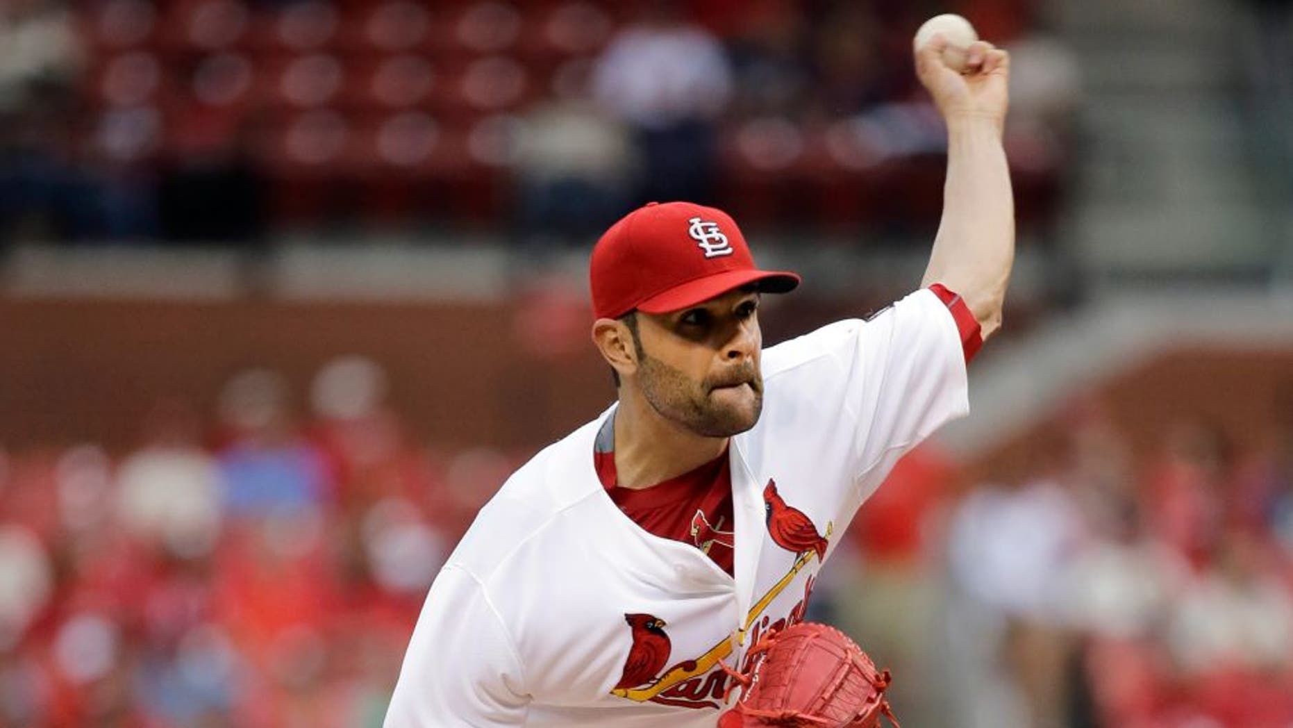 St. Louis Cardinals starting pitcher Jaime Garcia throws during the first inning of a baseball game against the San Francisco Giants, Wednesday, Aug. 19, 2015, in St. Louis. (AP Photo/Jeff Roberson)