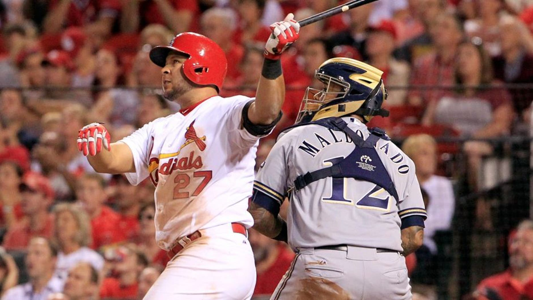 St. Louis Cardinals' Jhonny Peralta watches his three-run home run along side Milwaukee Brewers catcher Martin Maldonado during the fourth inning of a baseball game on Thursday, Sept. 24, 2015, in St. Louis. (AP Photo/Jeff Roberson)