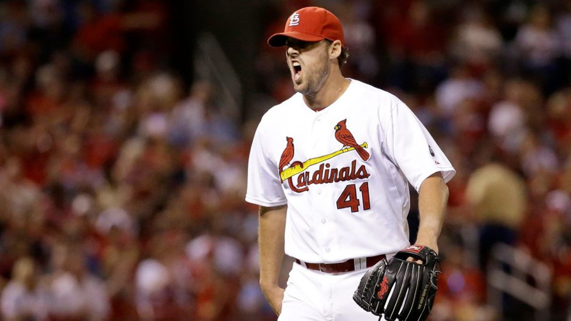 St. Louis Cardinals starting pitcher John Lackey yells as he walks off the field after getting Cincinnati Reds' Tucker Barnhart to line out to end the top of the seventh inning of a baseball game on Tuesday, Sept. 22, 2015, in St. Louis. (AP Photo/Jeff Roberson)