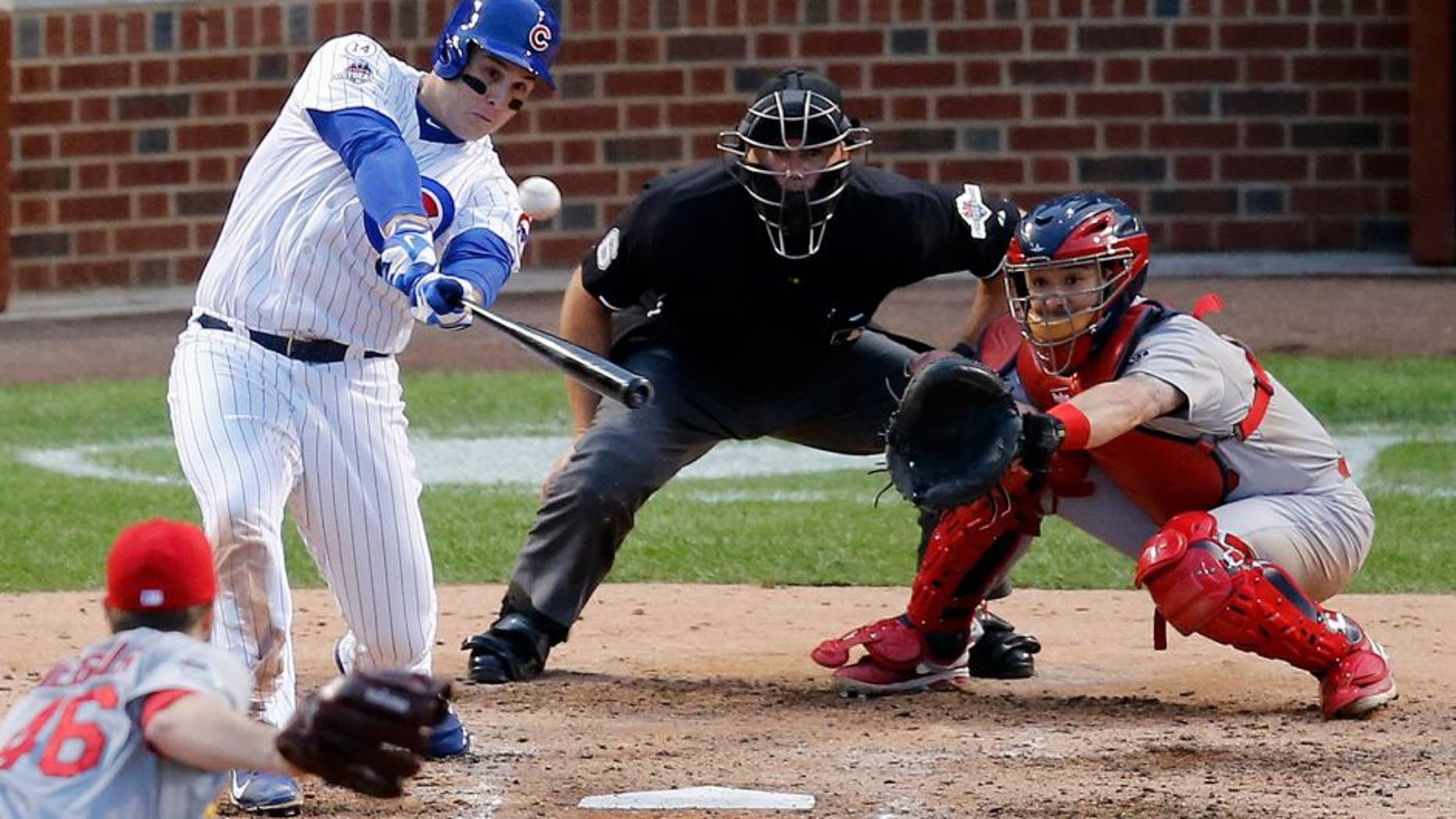 Chicago Cubs' Anthony Rizzo (44) hits a home run against the St. Louis Cardinals during the sixth inning of Game 4 in baseball's National League Division Series, Tuesday, Oct. 13, 2015, in Chicago. (AP Photo/Charles Rex Arbogast)