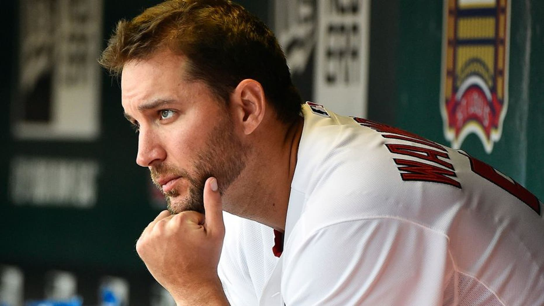 Apr 13, 2015; St. Louis, MO, USA; St. Louis Cardinals starting pitcher Adam Wainwright (50) sits in the dugout during the game against the Milwaukee Brewers at Busch Stadium. Mandatory Credit: Jasen Vinlove-USA TODAY Sports